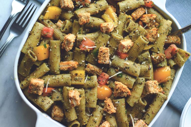 A vegan pesto pasta salad topped with diced Quorn Spicy Vegan Pieces.