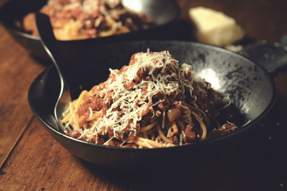 A bowl of spaghetti topped with Quorn Ground meat sauce and shredded parmesan cheese.