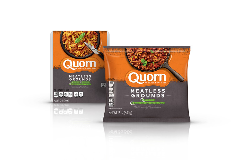 A bag and a box of Quorn Meatless Grounds showing the plated product and information on an orange and charcoal background.