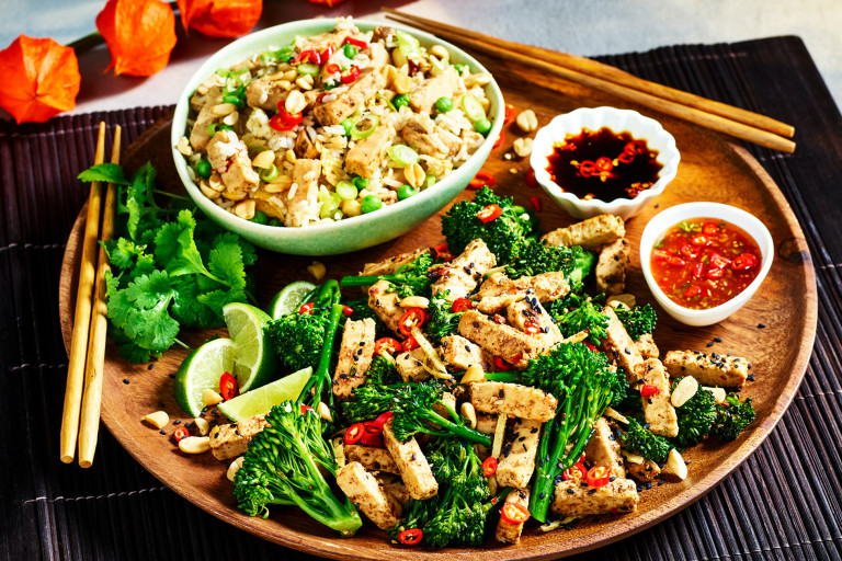 A Chinese-inspired sharing platter with fried rice with Quorn Chinese Inspired Salt & Pepper Strips and a broccoli and ginger stir fry with Quorn Chinese Inspired Salt & Pepper Strips and two sauces.