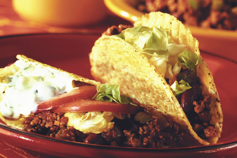 Veggie tacos recipe made with Quorn Mince chilli, lettuce, tomato, kidney beans and Greek yoghurt served on a plate