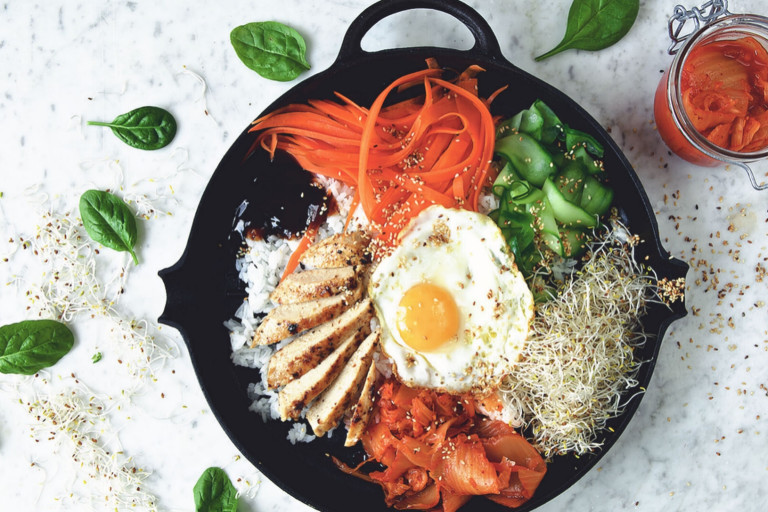 Vegetarian bibimbap made with Quorn Fillets served with rice, vegetables and egg in a skillet
