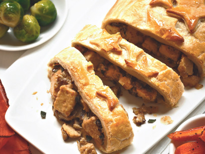 Vegetarian Christmas dishes made with Quorn Pieces, mushrooms and chestnuts stuffed in pastry and sliced, served on a plate