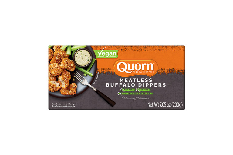 A box of Quorn Meatless Buffalo Dippers showing the product on a plate with celery sticks and blue cheese dip on the side and the product information on an orange and charcoal background.