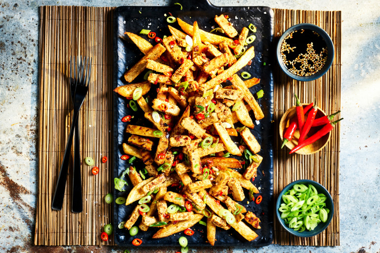 Chips topped with Quorn Chinese Inspired Salt & Pepper Strips, spring onions, and chilli.