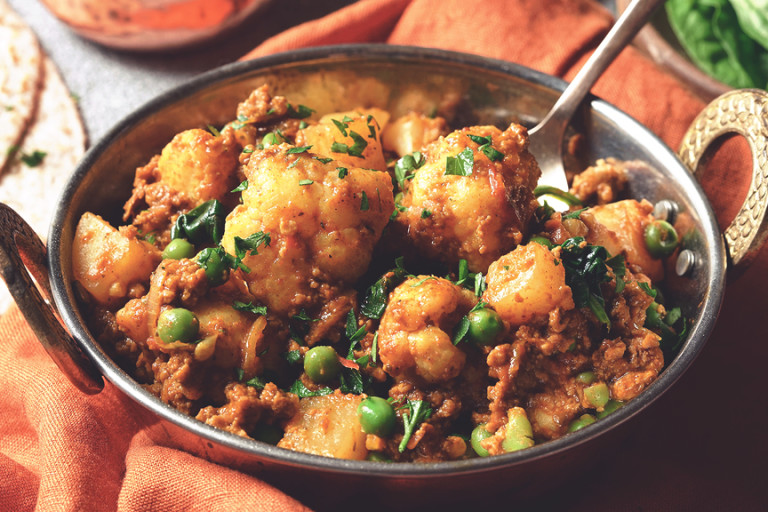 A Madras curry with Quorn Meatless Grounds, potato, peas, and cauliflower in a Balti dish.