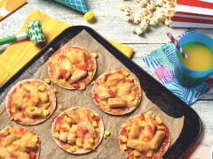 Small tortillas topped with tomato sauce, cheese, corn, and Quorn nuggets.
