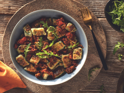 Vegetarian Gnocchi with a Quorn Mince Ragu, made with Quorn Mince, tomato, red wine, onion, garlic and cinnamon, served in a bowl.