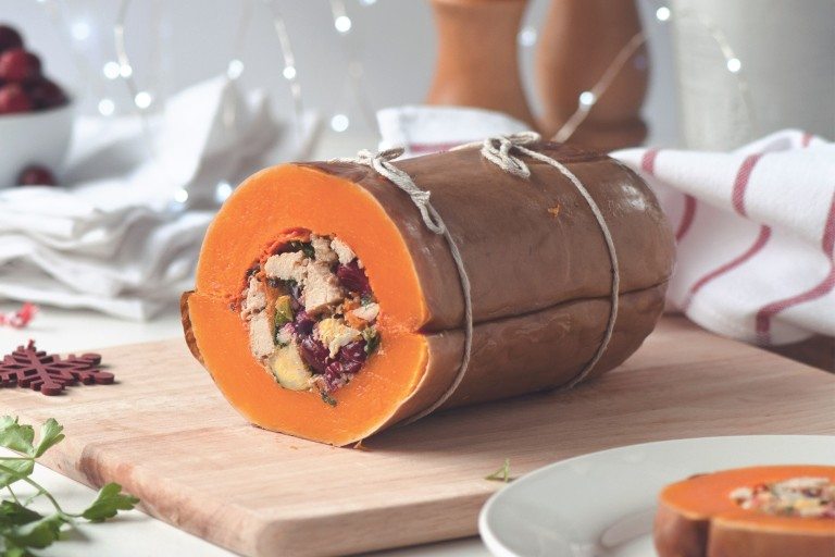 A butternut squash that has been stuffed with red onion, Brussels sprouts, cranberries, quinoa, and  Quorn Vegan Pieces.