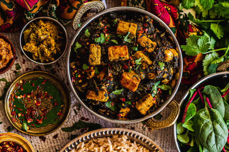 A vegan palak paneer made with spinach and Quorn Vegan Pieces topped with chilli and coriander in a balti dish.