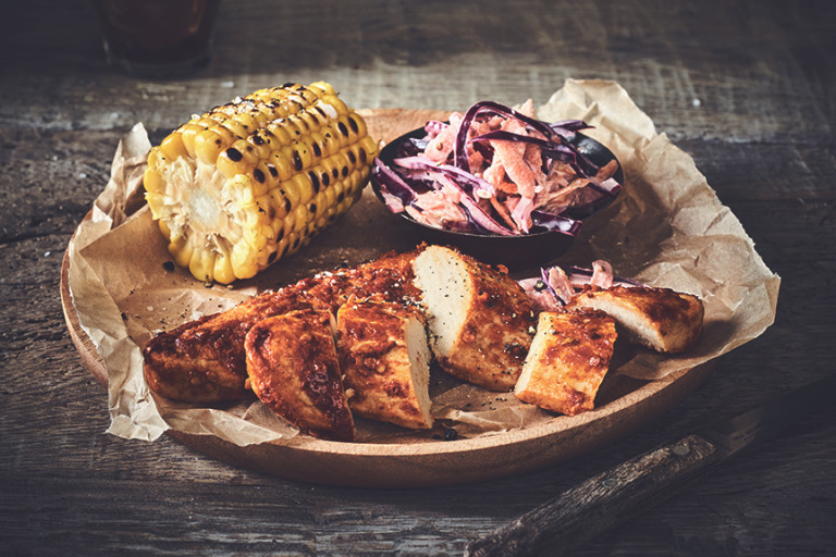 Healthy dinner idea made with Quorn Piri Piri Fillets and homemade slaw and a corn cob, served on baking paper