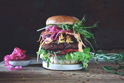 Burger recipe made with a Quorn Ultimate Burger layered with lettuce, beetroot, salad, pickled red onion and beansprouts