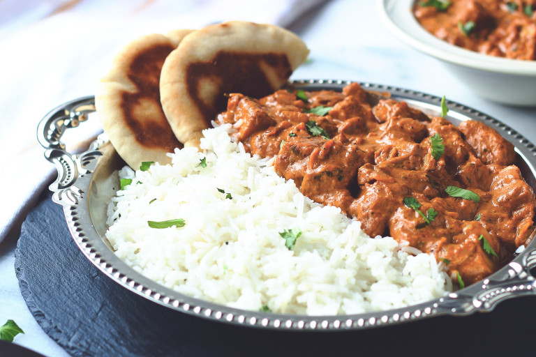 A vegan butter chicken curry made with Quorn Meatless Vegan Pieces served with a side of rice and naan bread.