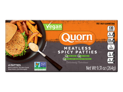 A box of Quorn Vegan Meatless Spicy Patties showing the plated product and information on a charcoal and orange background.