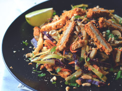 A Thai-inspired salad made with cabbage, carrots, onion, cashews, and cilantro topped with Quorn Vegan Meatless Chipotle Cutlets.