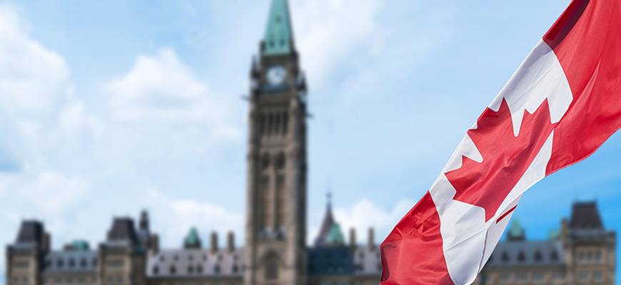 Canadian flag with parliament buildings