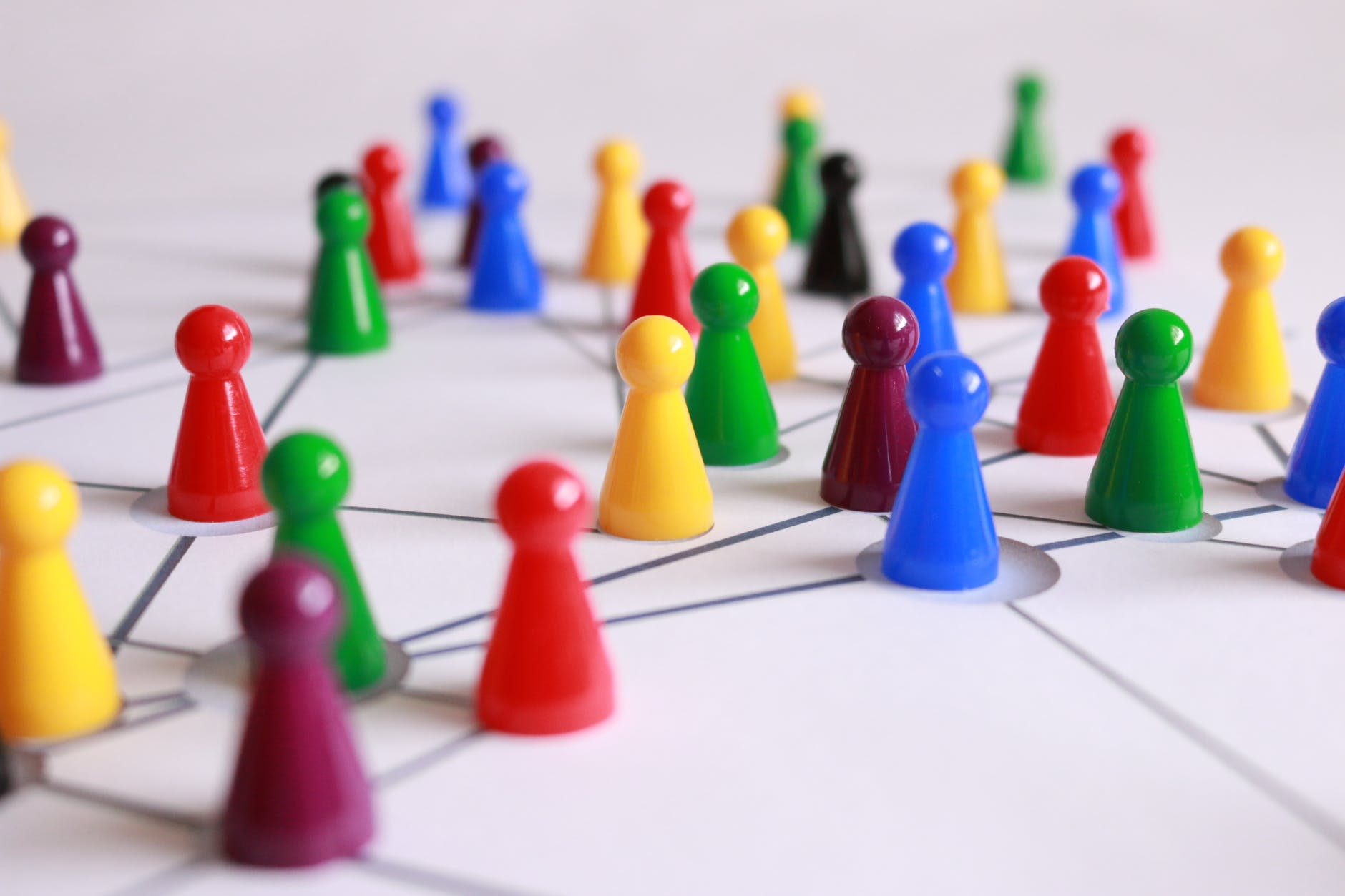 Multi-colored game pieces on an interconnected web