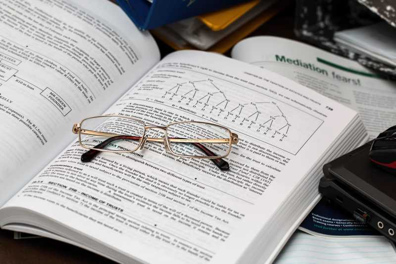 Data Research with glasses on textbook