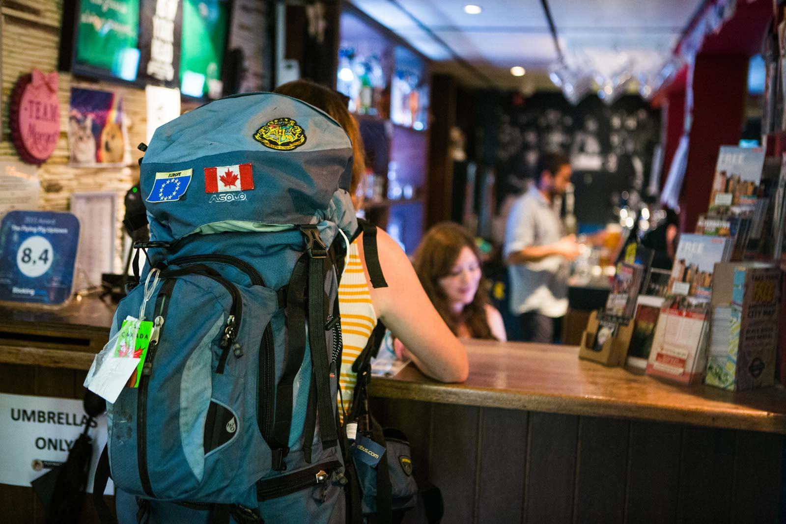 A backpacker checking into the the Flying Pig Uptown hostel.