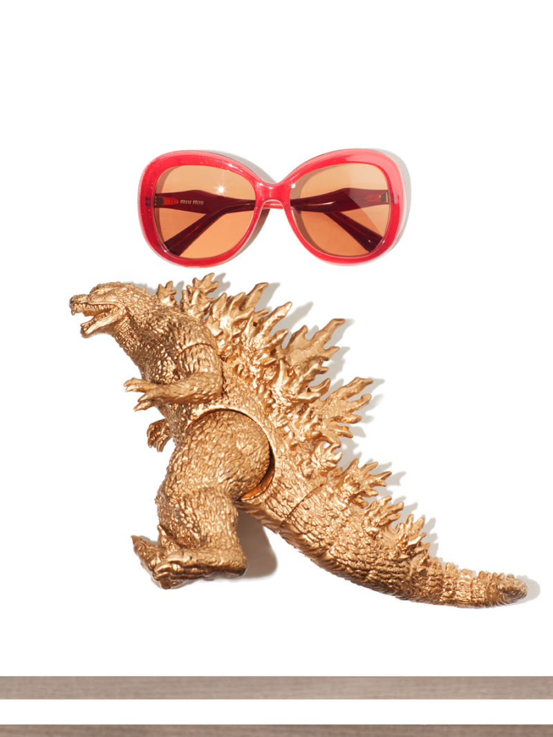Women's red sunglasses and gold Godzilla