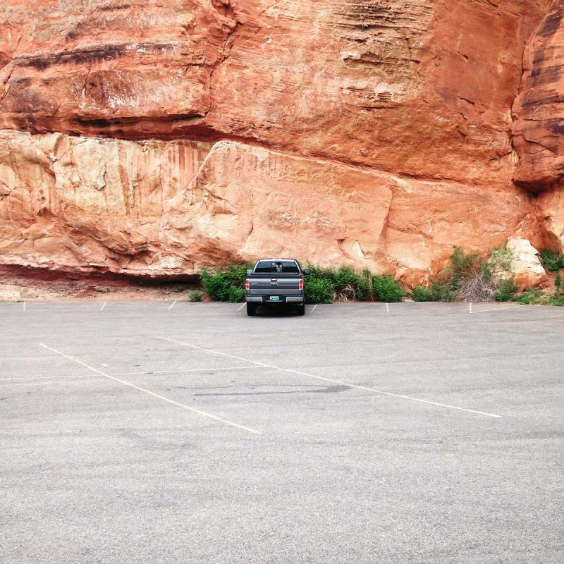 Truck against red cliffs