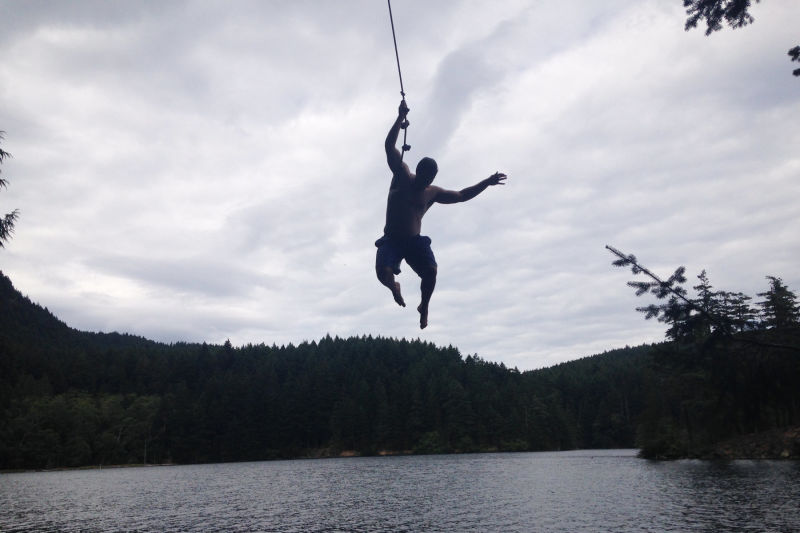 Man on rope swing