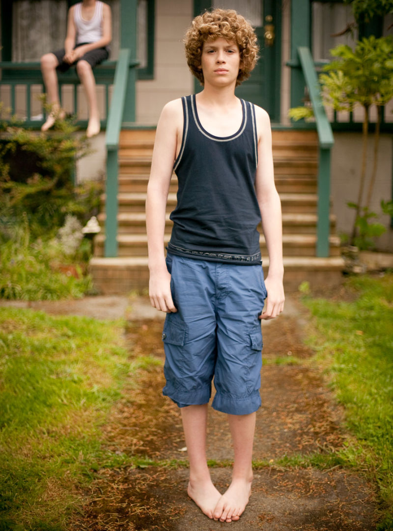 Boy in jeans and tank top