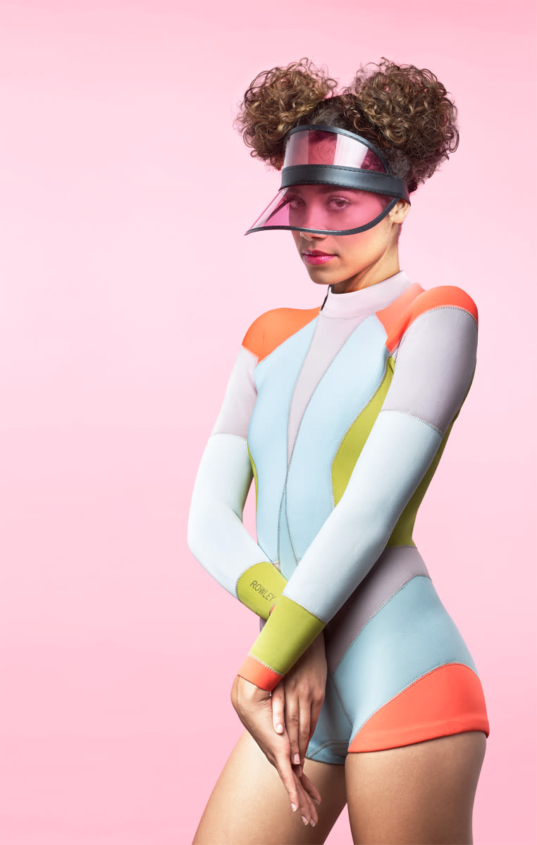 Woman in wetsuit with pink visor