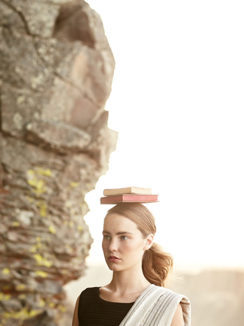 Woman with a book balanced on her head
