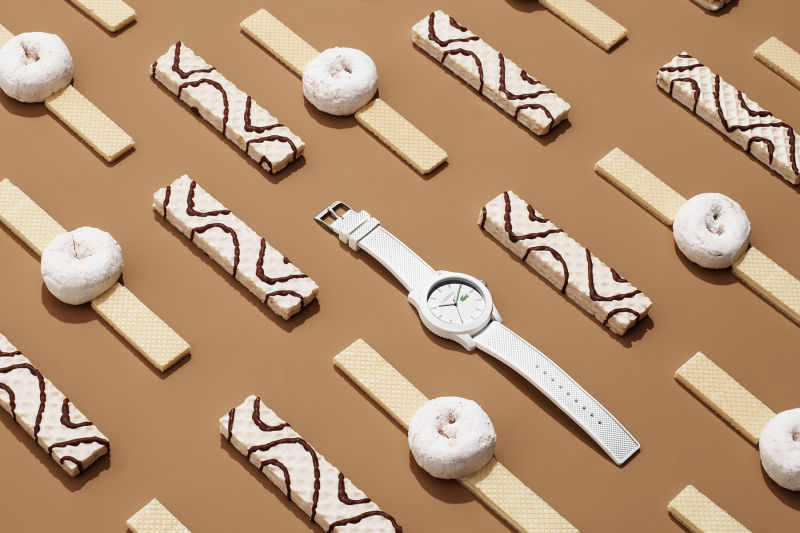 White Lacoste watch with cookies