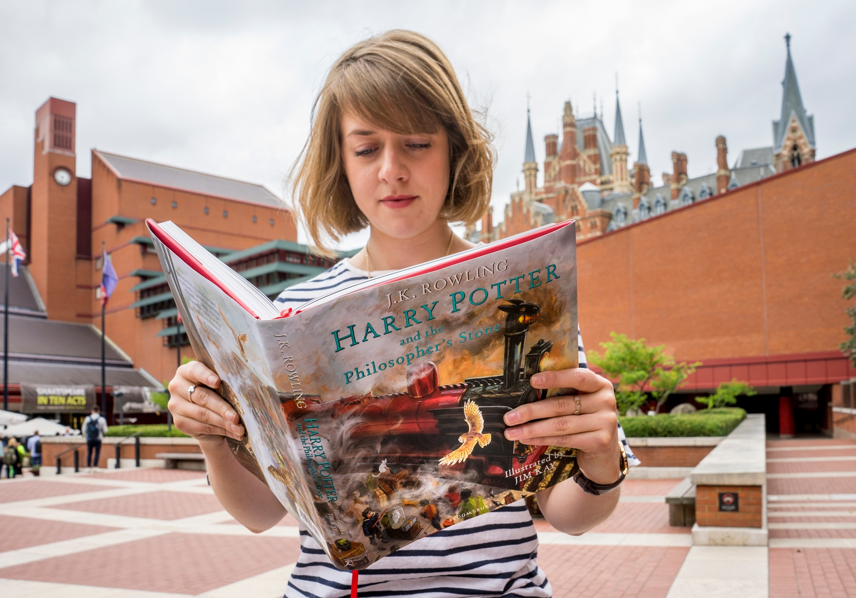 British Library employee reading Harry Potter and the Philosopher's Stone