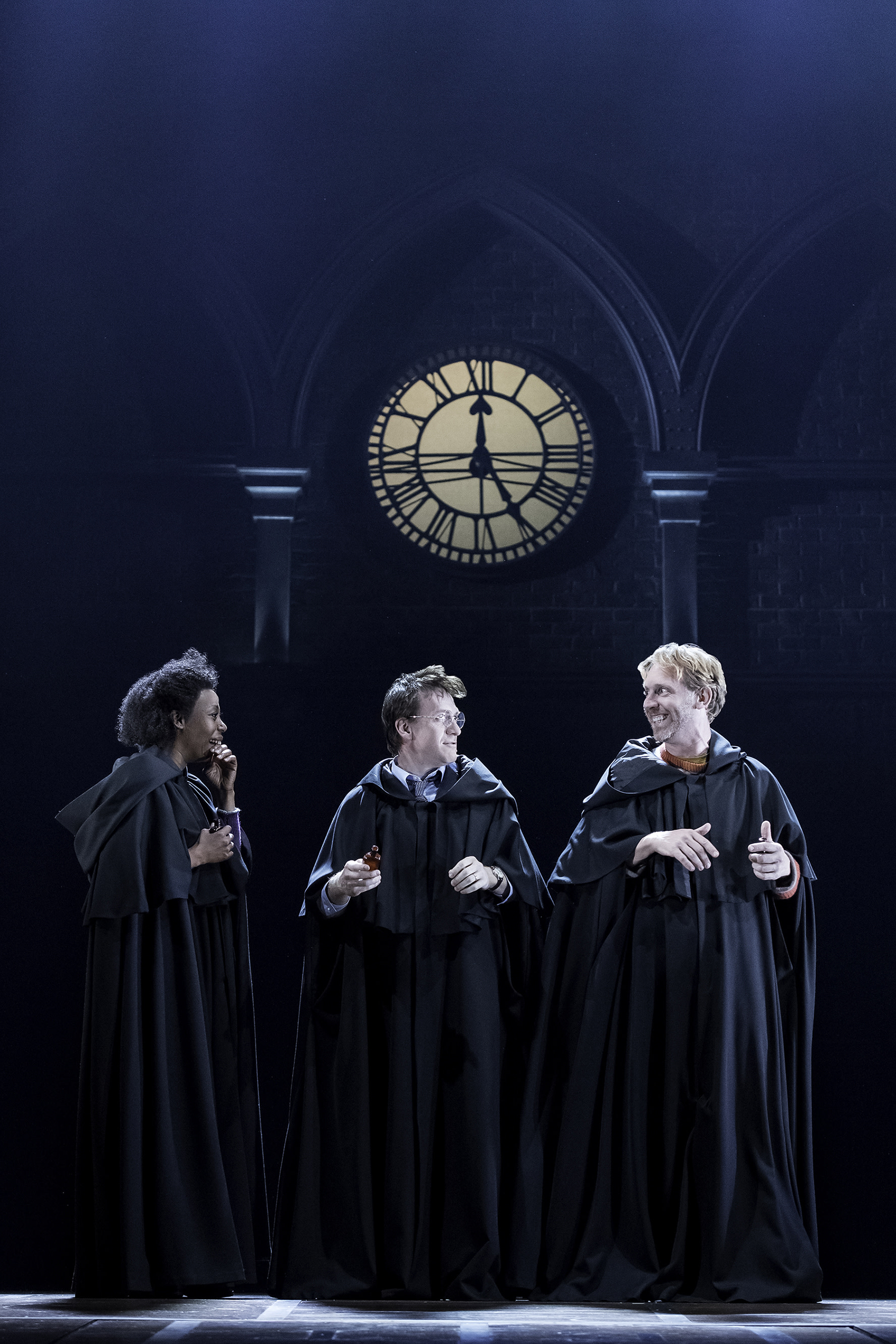 CC Broadway Noma Dumezweni Hermione Jamie Parker Harry Paul Thornley Ron wearing robes in front of clock AOB Premiere