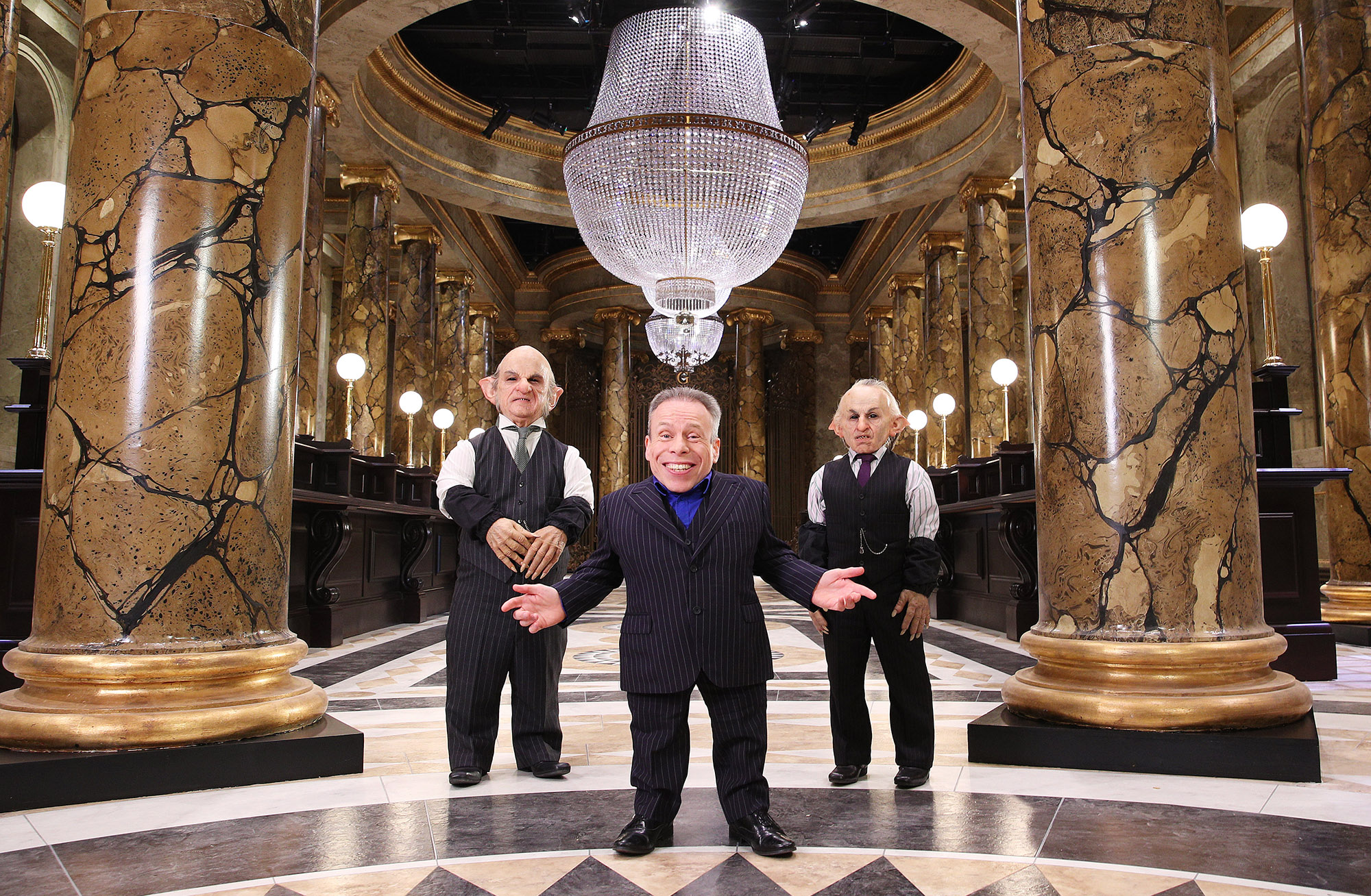 WBSTL Warwick Davis with Goblins at Gringotts display