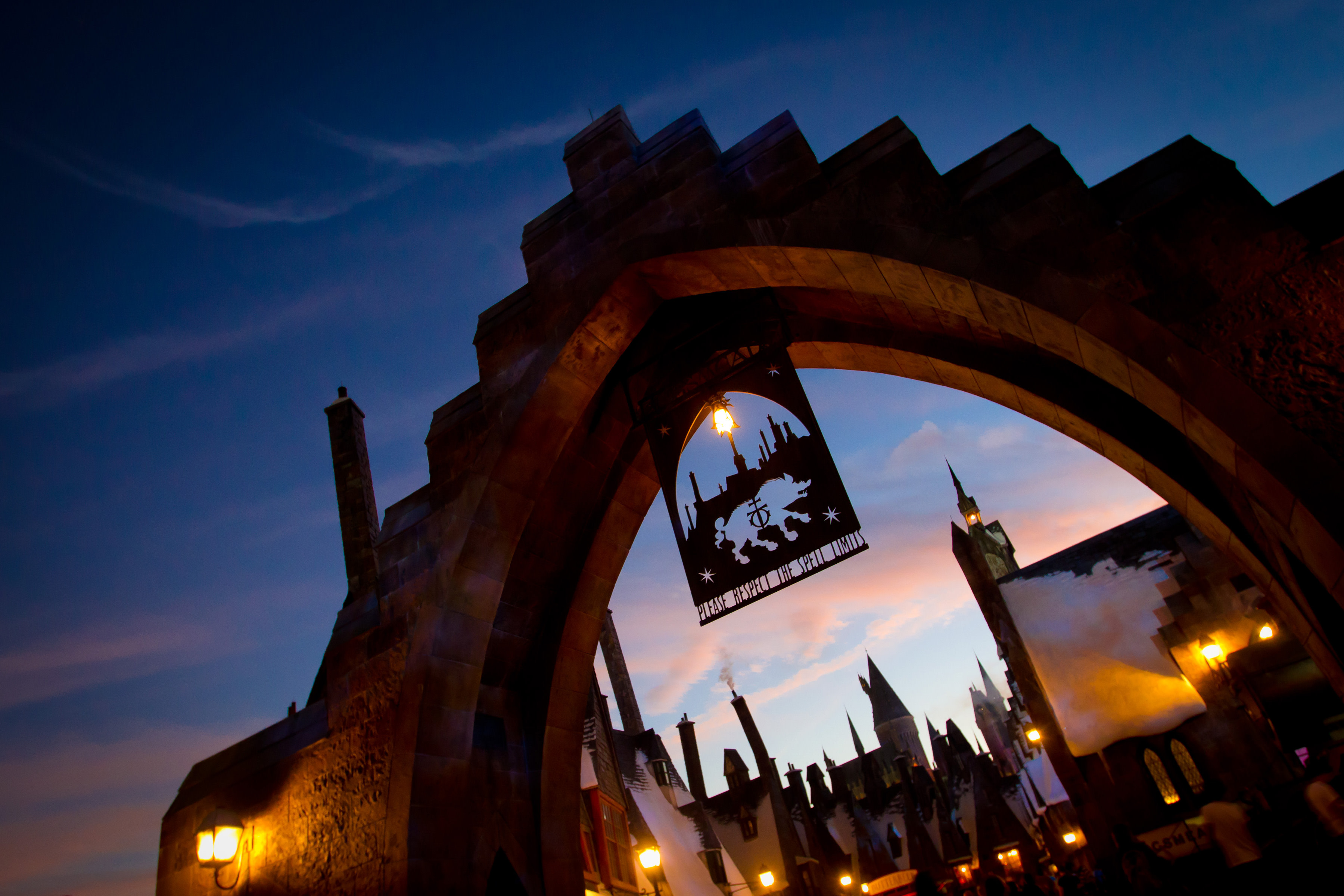 WWOHP Hogsmeade village attraction exterior night Universal Orlando