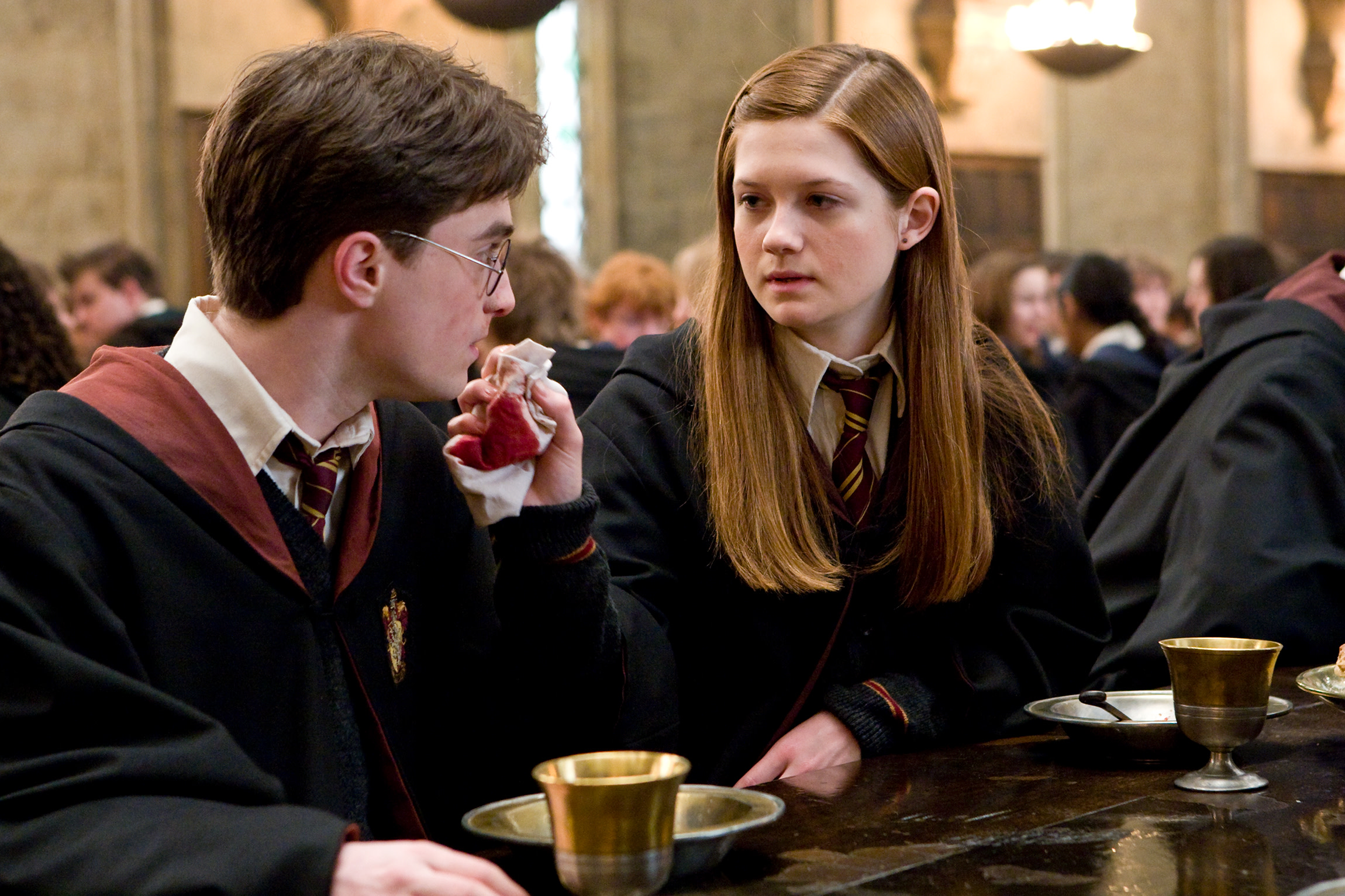 WB-HP-F6-half-blood-prince-ginny-harry-in-great-hall
