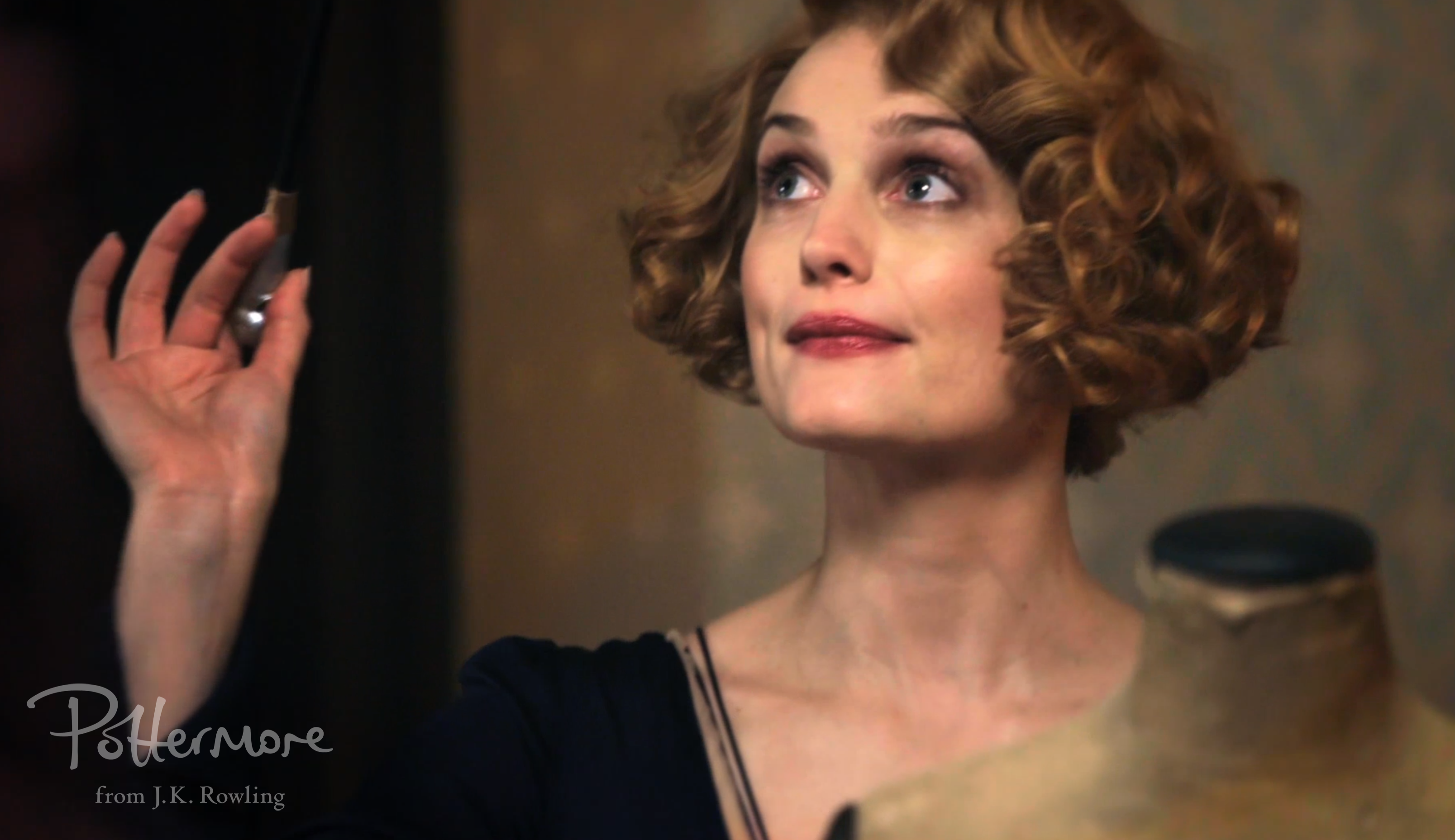 Alison Sudol as Queenie with wand, Celebration video shot