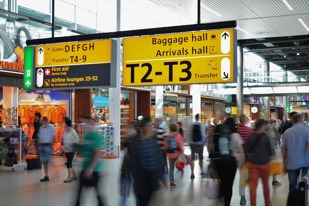 People at Amsterdam Airport - Get through airport security faster