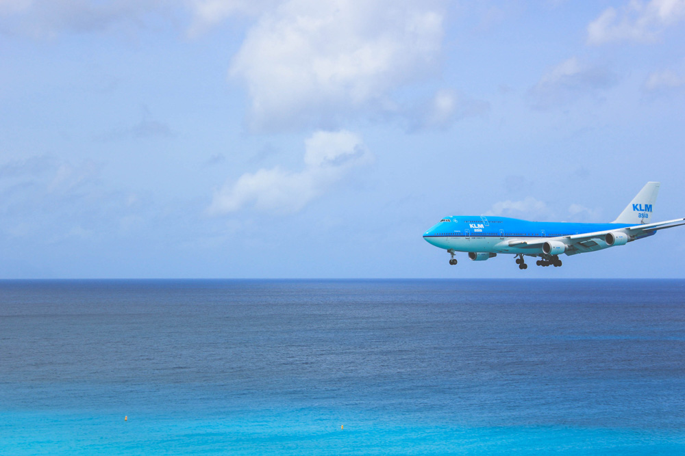 KLM aircraft flying over the sea
