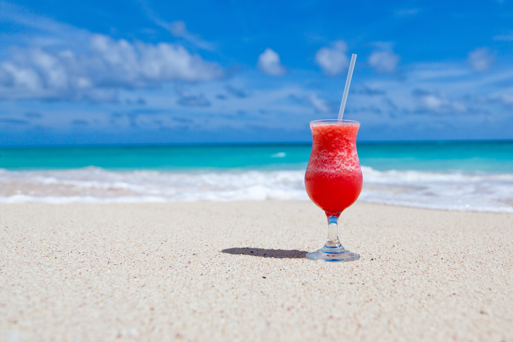 A glass of cocktail on the beach in Mexico - Best holiday destinations 2019