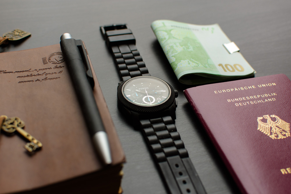 Passport, watch, cash are travel essentials