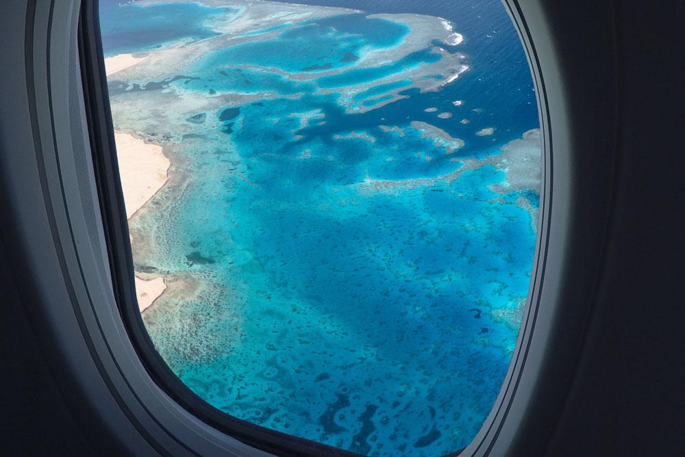 TUI airplane flying over island
