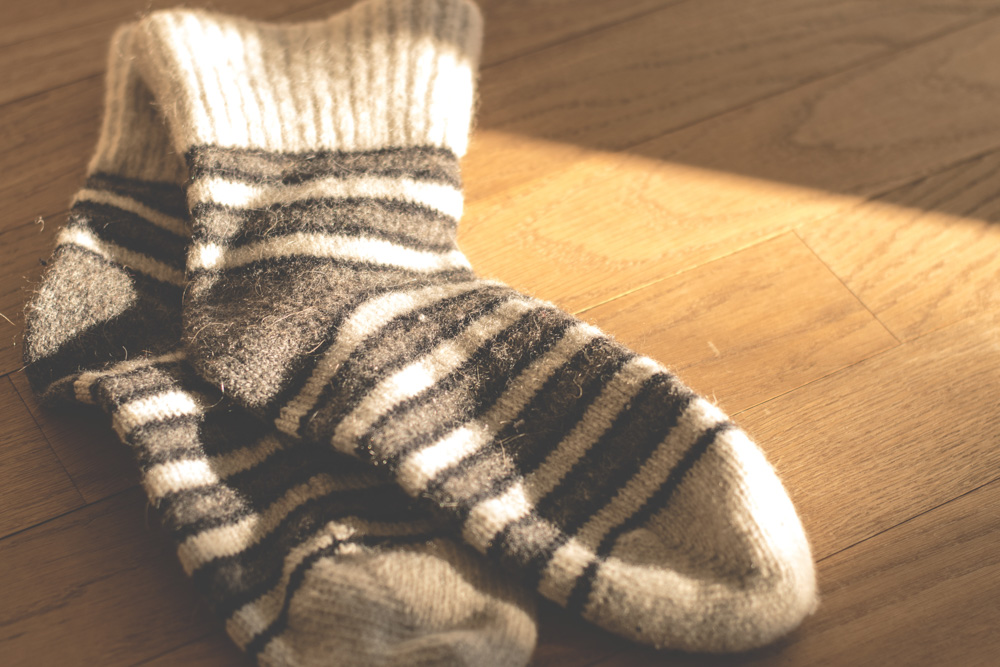 Warm socks lying on the floor