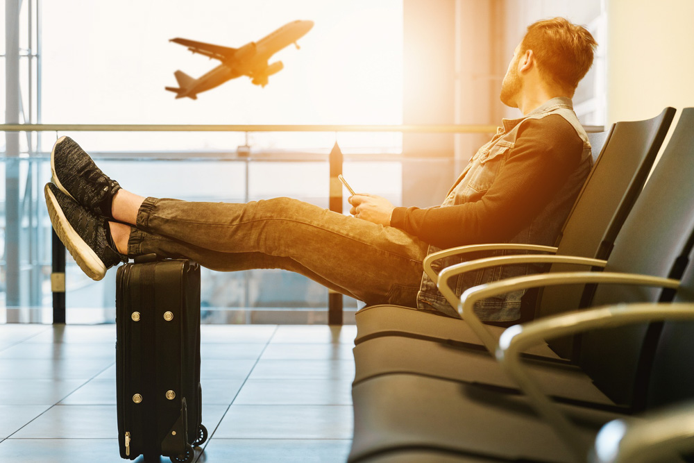 Guy sitting on the chair - Sleeping in airports