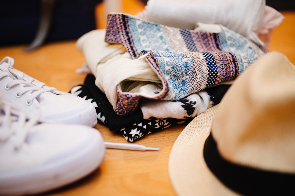 Shoes, clothes and hat on the table