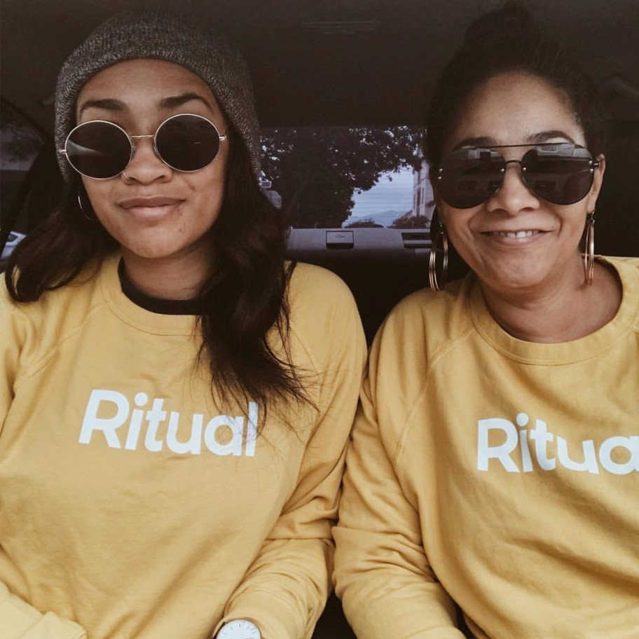 Mom and daughter with Ritual sweatshirt.