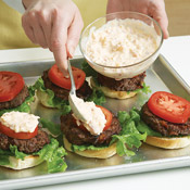 Dollop a spoonful of pimiento cheese on each tomato — it adds a little tanginess to the burger.