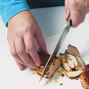 Allowing chicken to rest before slicing it across the grain yields pieces that are tender and juicy.
