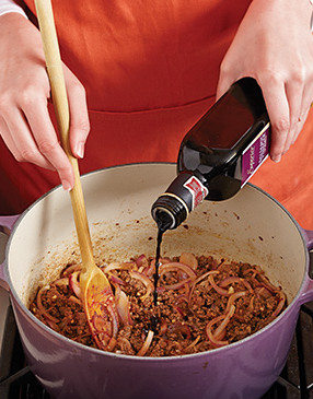 Deglaze the Dutch oven with a bit of balsamic vinegar, then reduce it to concentrate its flavor.