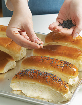 To make poppy seed buns, brush them with egg white, sprinkle with seeds, and bake at 400° for 5 minutes.