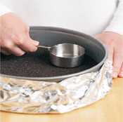 Tamping the crust with a heavy, flat-bottomed object like a glass or measuring cup ensures a firm crust.